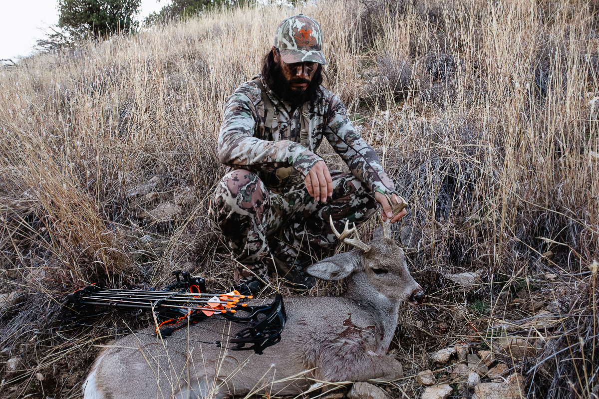 Josh Kirchner from Dialed in Hunter admiring his 2020 archery coues buck taken in Arizona
